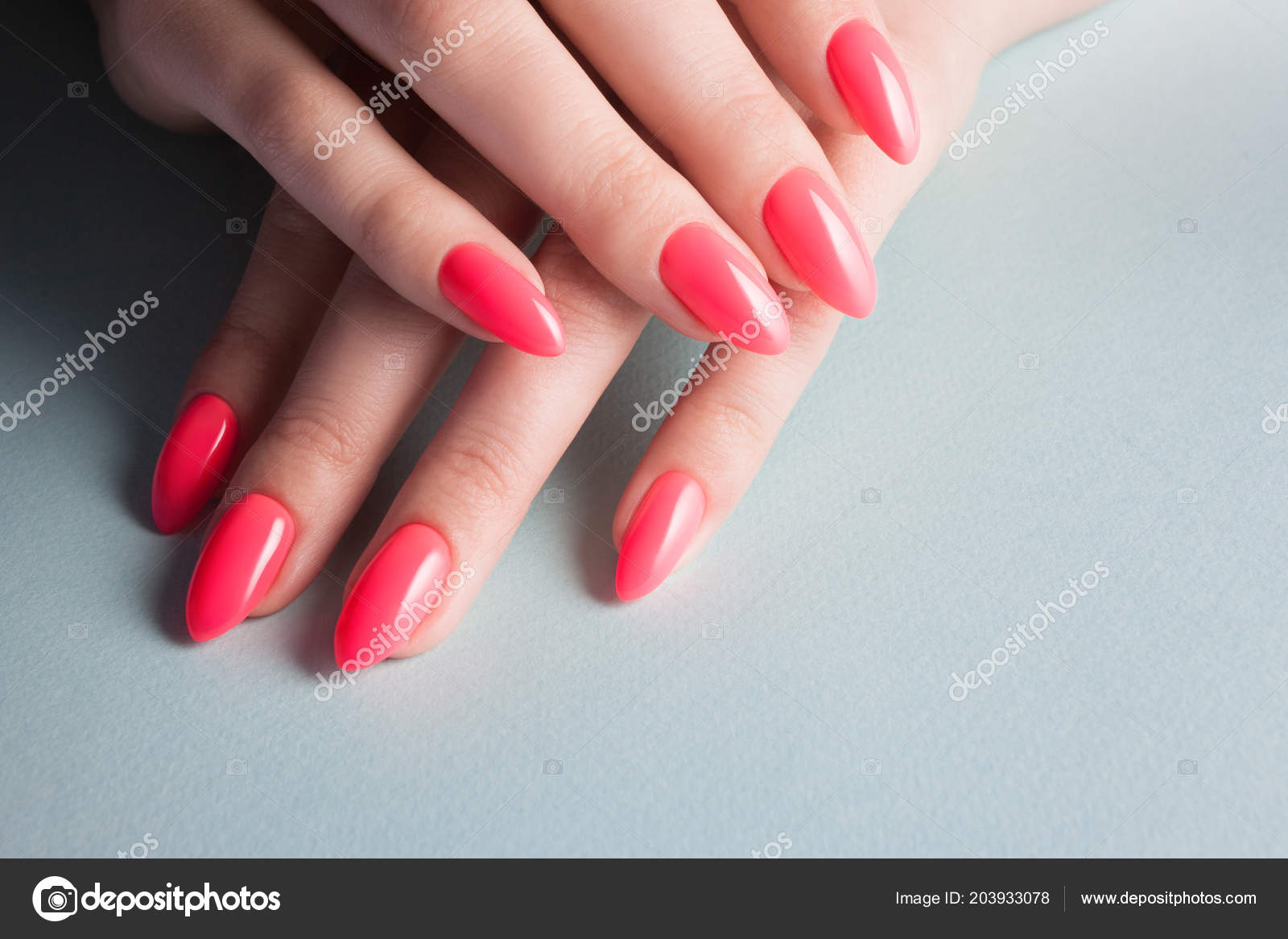 Women S Hands With Perfect Red Manicure Nail Polish Red Coral Color Blue Background Stock Photo C Kriscole 203933078